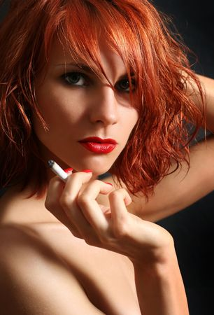 sexy young woman snoking cigarette Stock Photo - 5036650