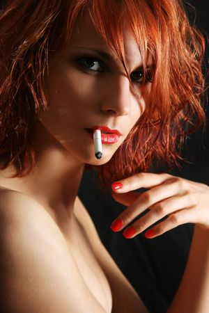 sexy young woman snoking cigarette Stock Photo - 5036698