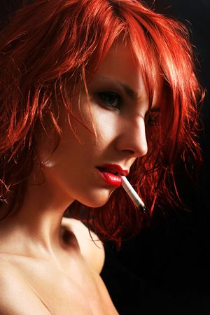 sexy young woman smoking cigarette Stock Photo - 5149831