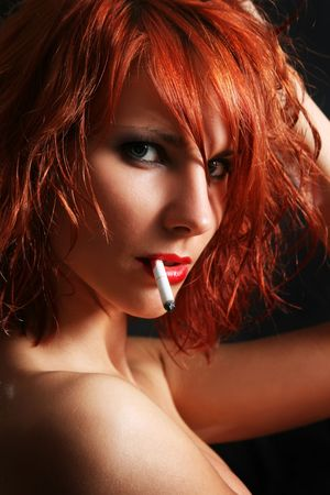 sexy young woman smoking cigarette photo