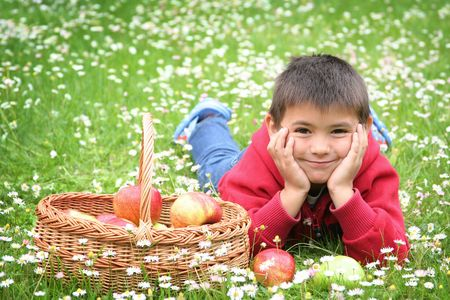 cute little boy with basket of apples