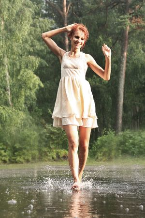 beautiful woman in the rain without an umbrella photo