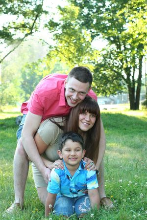 happy young family relaxing in park photo
