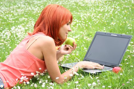cute young girl with laptop outdoors