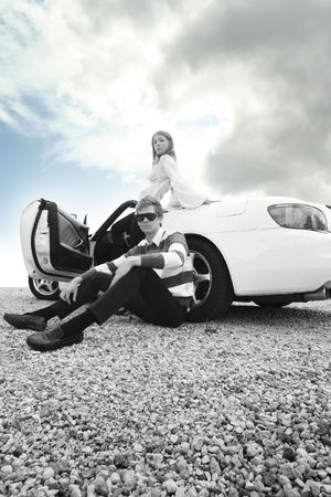 modern young couple in white car