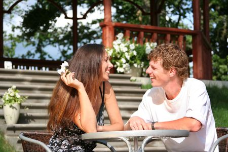 happy young couple relaxing in summer cofe Stock Photo - 5306171