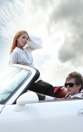 modern young couple in white car photo