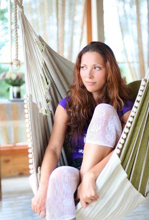 beautyful long-haired girl relaxing in hammock photo