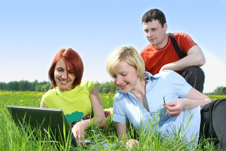 group of students relaxing outdoors photo