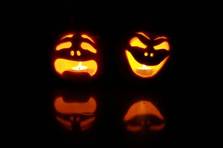 halloween pumpkins with faces like theatre masks