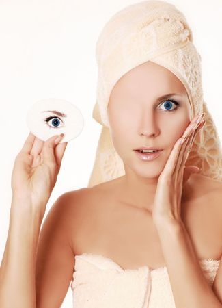 young woman removing make up from her face Stock Photo - 5533803
