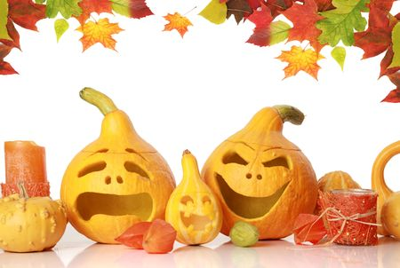 dried gourd: halloween pumpkins with funny faces on white