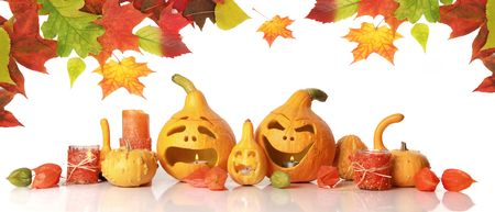 halloween pumpkins with funny faces on white photo