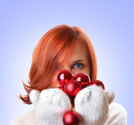 cute young girl with christmas balls photo