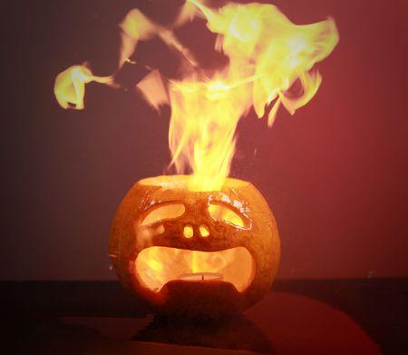 burning haloween pumpkin on dark background Stock Photo - 5701192