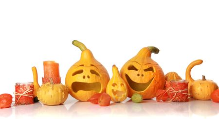 halloween pumpkins with funny faces on white