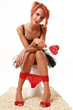 funny girl with red lollipop in the toilet photo
