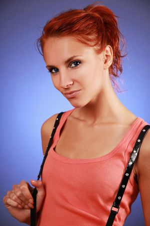 sexy redhead woman on blue background photo