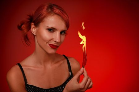 beautiful woman with red hot pepper