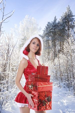 young Santa-girl with presents in forest