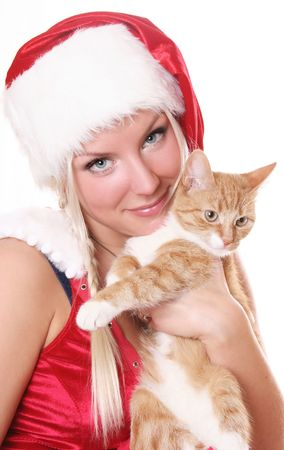 blue-eyed santa girl with fluffy kitten photo