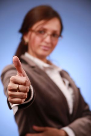 young businesswoman showing thumb up (hand in focus)  photo