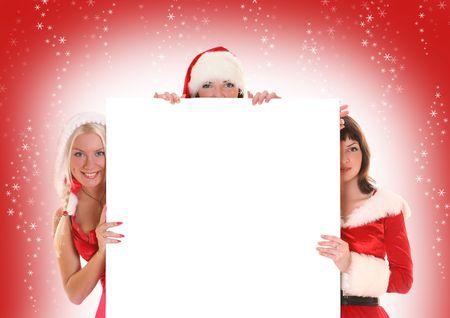 three beautiful Santa-girls holding white banner