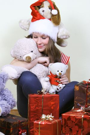 cute young girl with toys and presents Stock Photo - 5768605
