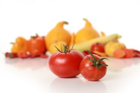 sweet red tomatoes isolated on white (little tomatoe in focus) photo