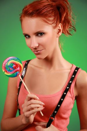 funny young woman with lollypop photo