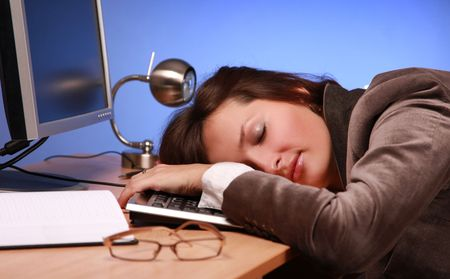 sleeping at desk: beautiful businesswoman asleep at work Stock Photo