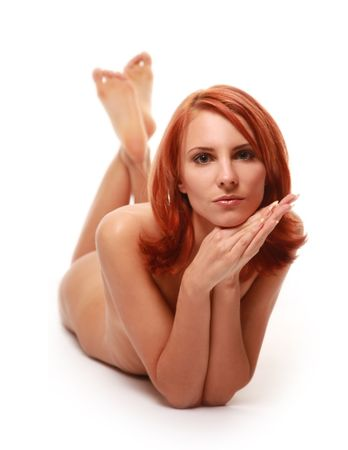 beautiful redhaired girl naked in studio Stock Photo
