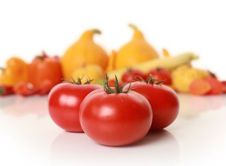 sweet red tomatoes isolated on white photo