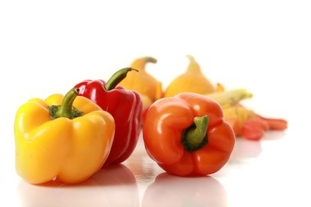 sweet colorful peppers isolated on white photo