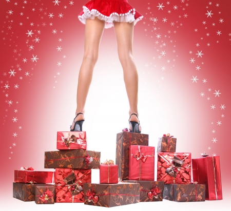 sexy santa girl: sexy young Santa-girl with gift boxes Stock Photo
