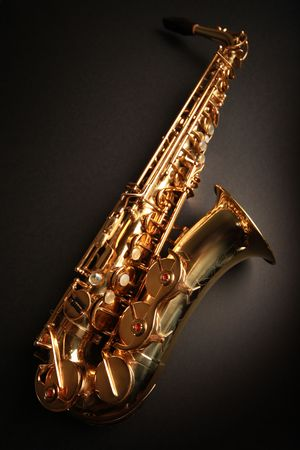 golden shiny saxophone on black background Stock Photo - 5852490