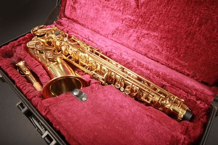 shiny golden sax in suitcase Stock Photo - 5852342