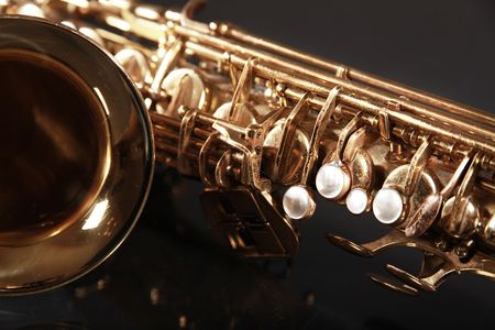 golden shiny saxophone on black background Stock Photo - 5852333