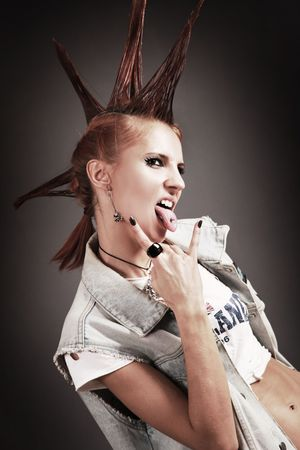 girl tongue: beautiful young punk-girl on dark background Stock Photo