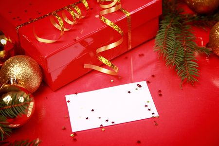 christmas background with golden balls and present Stock Photo - 5852336