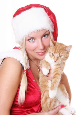 blue-eyed santa girl with fluffy kitten photo
