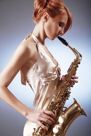 sexy young woman with saxophone Stock Photo - 5836359