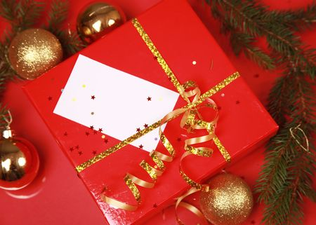 christmas background with golden balls and present Stock Photo - 5852347