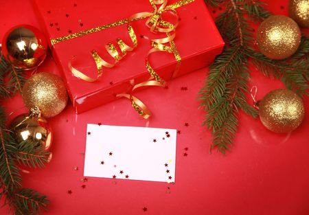 christmas background with golden balls and present Stock Photo - 5852339