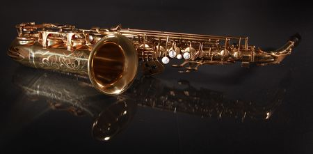 golden shiny saxophone on black background Stock Photo - 5852340