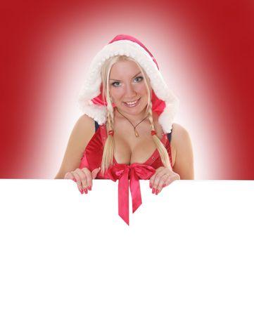 dona: sexy rubia Sra. Santa, sosteniendo la cartelera blanco Foto de archivo