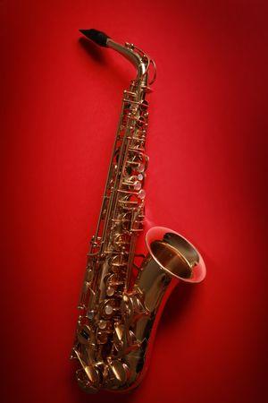 golden shiny saxophone on red background Stock Photo - 5852344