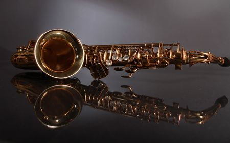 golden shiny saxophone on black background photo