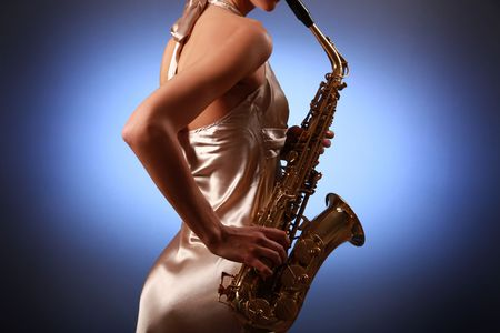sexy young woman with saxophone Stock Photo - 5836407