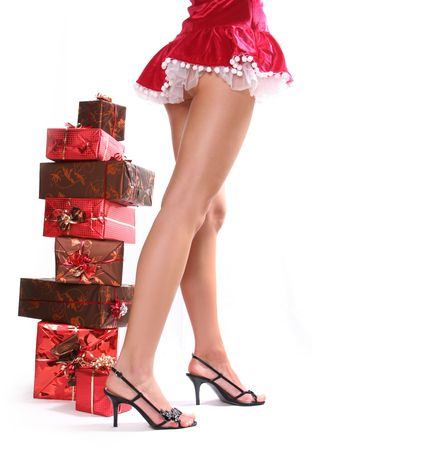 mrs: sexy young Santa-girl with gift boxes Stock Photo